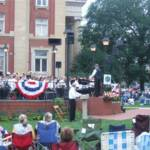 "Assistant Director, Ken Jewell, conducted ""Armed Forces Salute"""