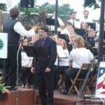 "Mr. Priano led the audience in the singing of ""God Bless America"""