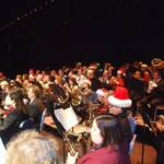 "Many band members were decked out in Santa hats in honor of the ""Jolly Old Elf""."
